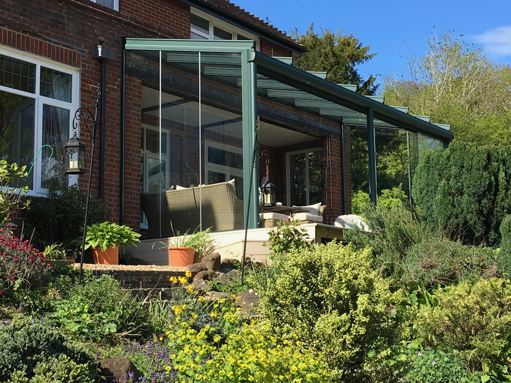 Lovely green aluminium glazed sunroom / veranda