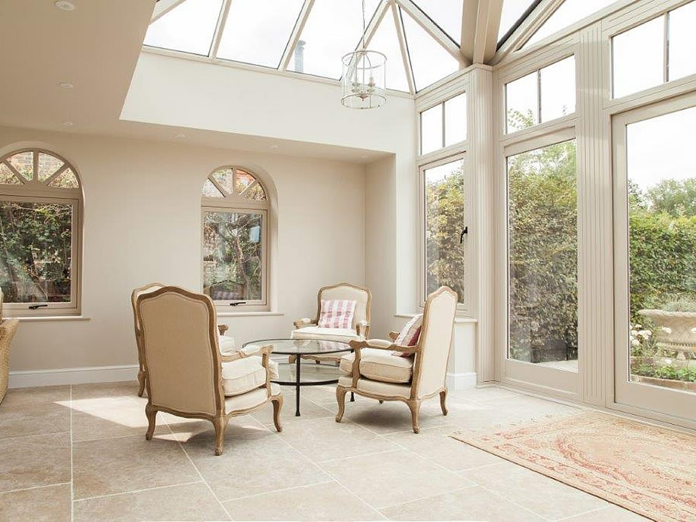 Inside a bespoke orangery / conservatory. Inside a grand glass house in Billingshurst