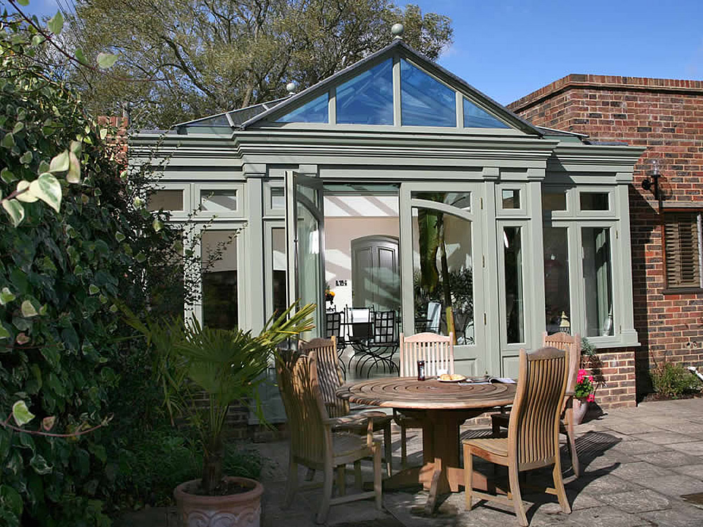A gorgeous dining room conservatory in traditional style