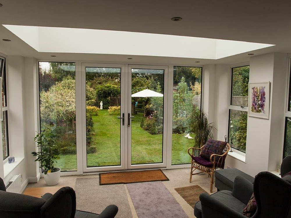 Inside an orangery. Designed in white aluminium makes for a delightful serene garden room