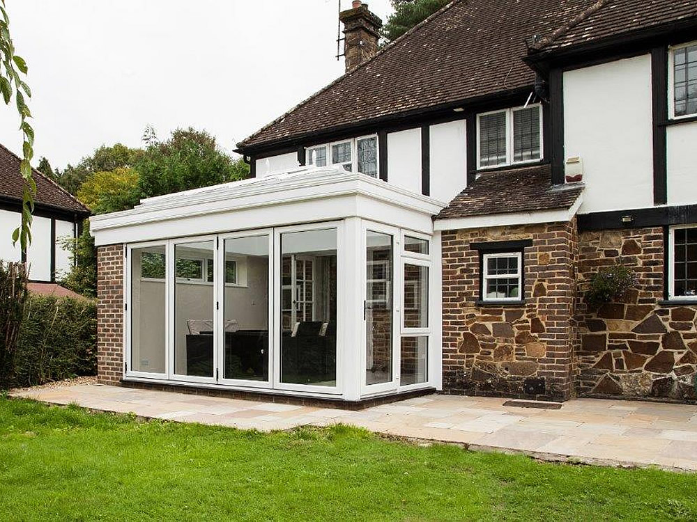 Orangery with bifolding doors. The bifold doors give maximum light and visibility.